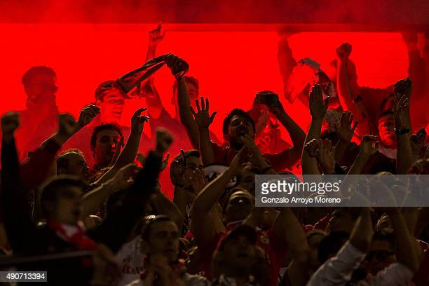 Benfica fans light flares after their teams first goal during the UEFA Champions League Group C match between Club Atletico de Madrid and SL Benfica...