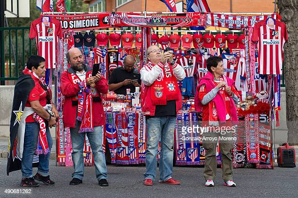 Benfica fans take selfies in front of a merchandaising stall at Vicente Calderon Stadium before the UEFA Champions League Group C match between Club...