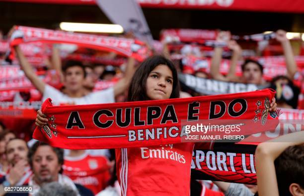 A Benfica football fan displays her scarf during the Portuguese league football match SL Benfica vs Vitoria Guimaraes SC at the Luz stadium in Lisbon...