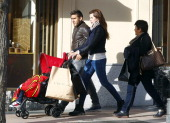 Benfica football player Eduardo Antonio Salvio his wife Magali Aravena and son are seen on March 3 2014 in Madrid Spain