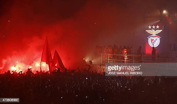 Benfica football players and fans celebrate their 34th Portuguese league title with the trophy as they parade on top an open bus in downtown Lisbon...