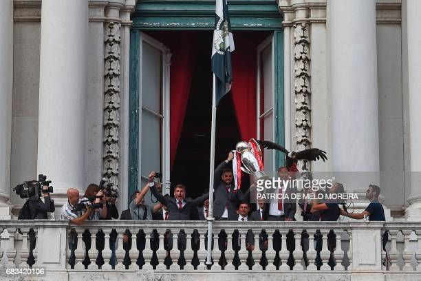 Benfica football team raise their trophy at Lisbon's City Hall as they celebrate their victory in the 20162017 Portuguese League championship the...