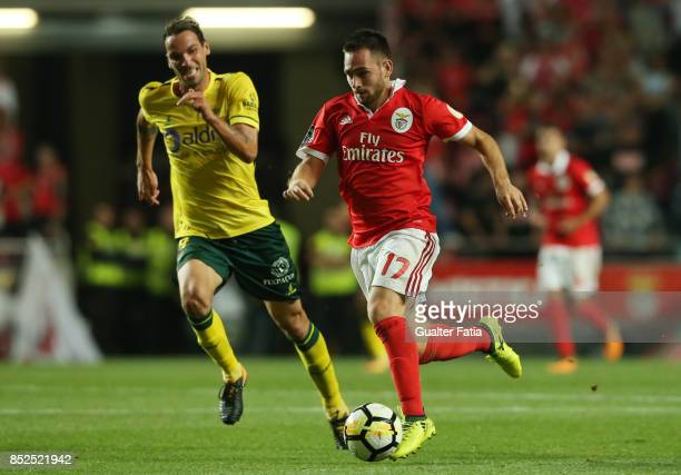 Benfica forward Andrija Zivkovic from Serbia with FC Pacos de Ferreira midfielder Andre Leao from Portugal in action during the Primeira Liga match...