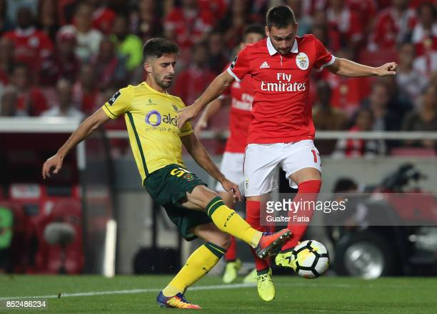 Benfica forward Andrija Zivkovic from Serbia with FC Pacos de Ferreira forward Antonio Xavier from Portugal in action during the Primeira Liga match...