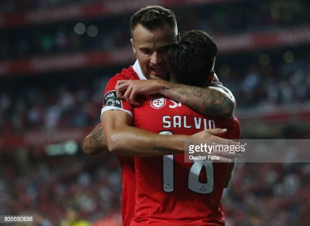 Benfica forward Eduardo Salvio from Argentina celebrates with teammate SL Benfica forward Haris Seferovic from Switzerland after scoring a goal...