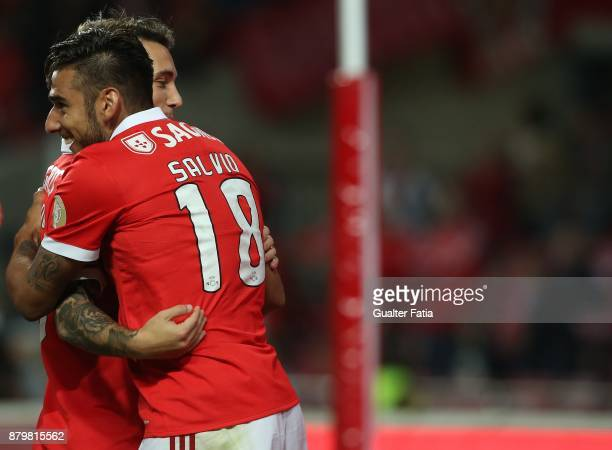Benfica forward Eduardo Salvio from Argentina celebrates with teammate SL Benfica defender Alejandro Grimaldo from Spain after scoring a goal during...