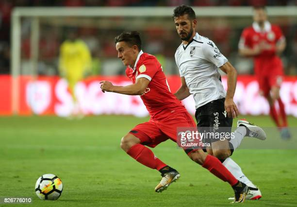 Benfica forward Franco Cervi from Argentina with Vitoria Guimaraes defender Joao Aurelio from Portugal in action during the SuperTaca match between...