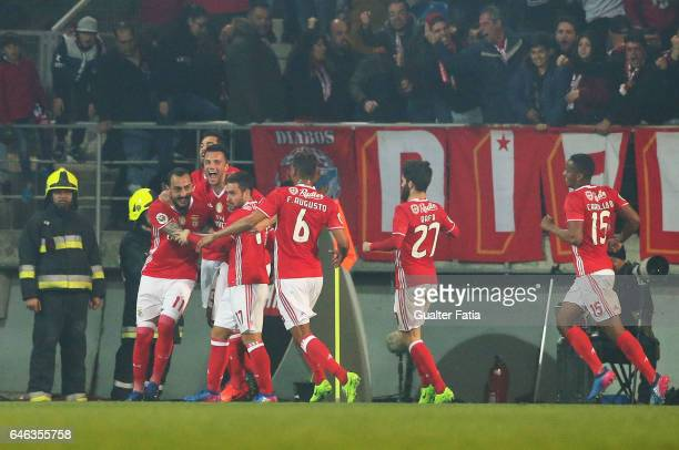 Benfica forward from Greece Kostas Mitroglou celebrates with teammates after scoring a goal during the Portuguese Cup Semi Final First Leg match...