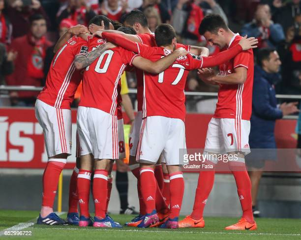 Benfica forward from Greece Kostas Mitroglou celebrates with teammates after scoring a goal during the Primeira Liga match between SL Benfica and CF...