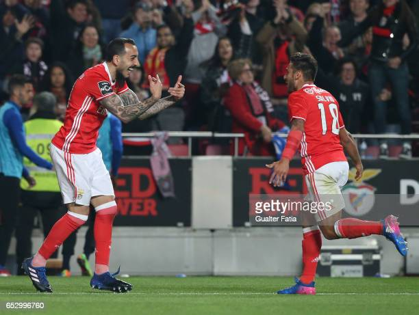 Benfica forward from Greece Kostas Mitroglou celebrates with teammate SL Benfica midfielder from Argentina Salvio after scoring a goal during the...