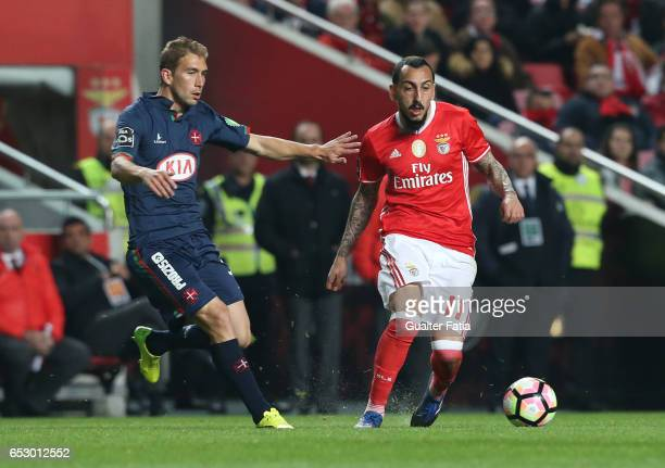 Benfica forward from Greece Kostas Mitroglou with Belenenses's defender Goncalo Silva from Portugal in action during the Primeira Liga match between...