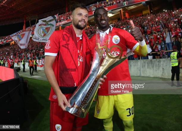 Benfica forward Haris Seferovic from Switzerland and SL Benfica goalkeeper Bruno Varela from Portugal celebrate with trophy after winning the...