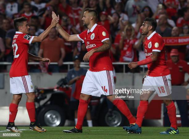 Benfica forward Haris Seferovic from Switzerland celebrates with teammates after scoring a goal after scoring a goal during the Primeira Liga match...