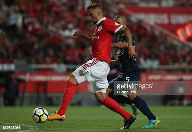 Benfica forward Haris Seferovic from Switzerland with CF Os Belenenses defender Nuno Tomas from Portugal in action during the Primeira Liga match...