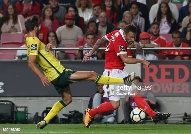 Benfica forward Haris Seferovic from Switzerland with FC Pacos de Ferreira defender Rui Correia from Portugal in action during the Primeira Liga...