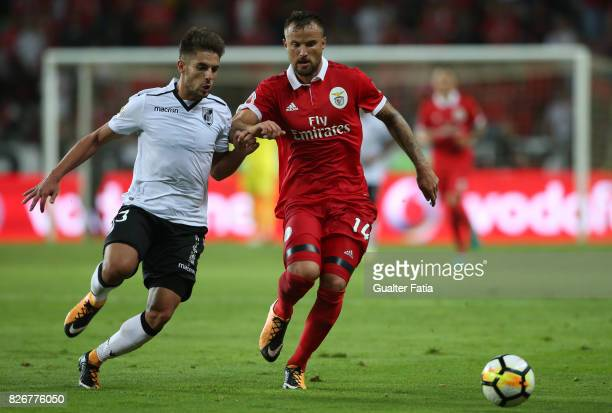 Benfica forward Haris Seferovic from Switzerland with Vitoria Guimaraes defender Joao Vigario from Portugal in action during the SuperTaca match...