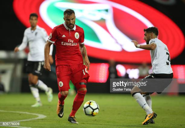 Benfica forward Haris Seferovic from Switzerland with Vitoria Guimaraes defender Josue Sa from Portugal in action during the SuperTaca match between...