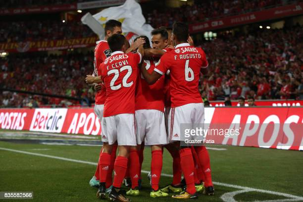 Benfica forward Jonas from Brazil celebrates with teammates after scoring a goal during the Primeira Liga match between SL Benfica and CF Os...