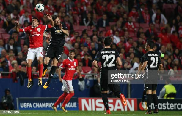 Benfica forward Raul Jimenez battles with Manchester United FC defender Victor Lindelof during the UEFA Champions League match between SL Benfica and...