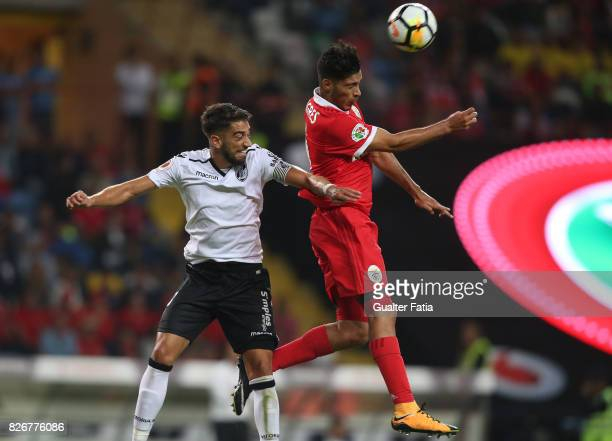 Benfica forward Raul Jimenez from Mexico with Vitoria Guimaraes defender Josue Sa from Portugal in action during the SuperTaca match between SL...