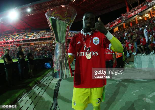 Benfica goalkeeper Bruno Varela from Portugal celebrates with trophy after winning the SuperTaca Cup at the end of the SuperTaca match between SL...
