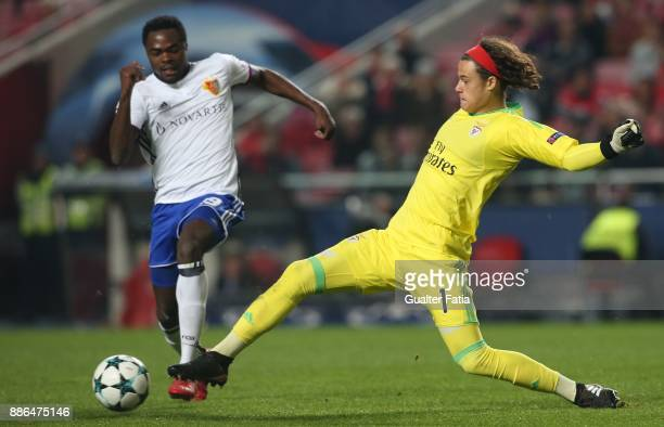 Benfica goalkeeper Mile Svilar from Belgium with FC Basel forward Dimitri Oberlin from Switzerland in action during the UEFA Champions League match...