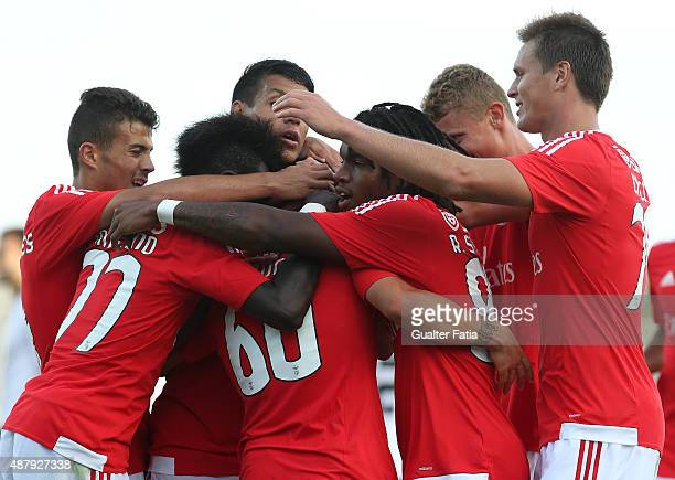 Benfica II's defender Pedro Rebocho celebrates with teammates after scoring a goal during the Primeira Liga match between SL Benfiva II and Academica...