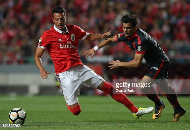 Benfica midfielder Andreas Samaris from Greece tackled by Joao Carlos Teixeira during the Portuguese League Cup match between SL Benfica and SC Braga...