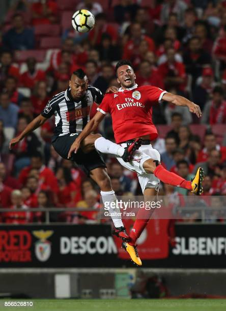 Benfica midfielder Andreas Samaris from Greece with Portimonense SC midfielder Fabricio Messias from Brazil in action during the Primeira Liga match...