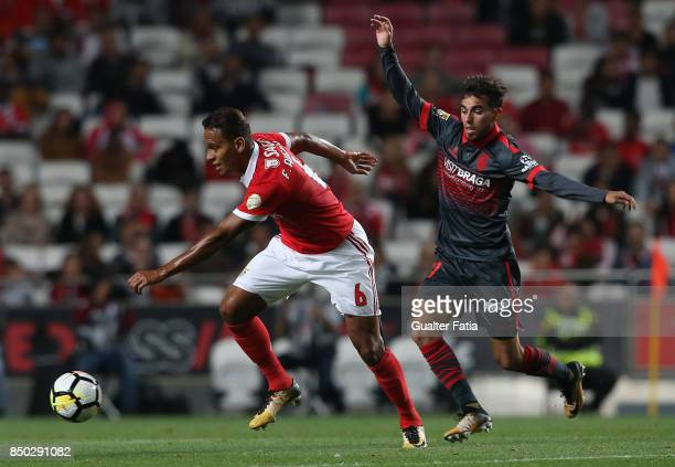 Benfica midfielder Filipe Augusto from Brazil with SC Braga forward Ricardo Horta from Portugal in action during the Portuguese League Cup match...