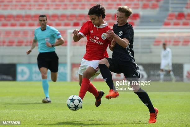 Benfica midfielder Joao Felix with Manchester United FC midfielder Indy Boonen in action during the UEFA Youth League match between SL Benfica and...