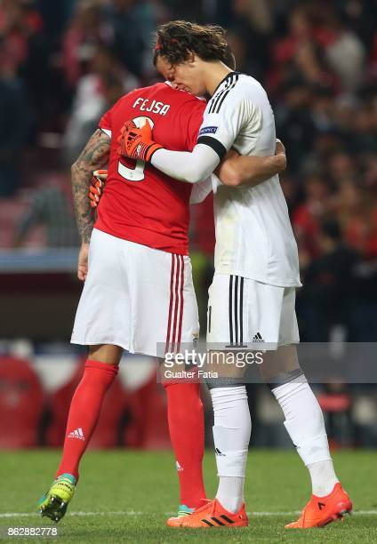 Benfica midfielder Ljubomir Fejsa from Serbia comforts teammate SL Benfica goalkeeper Mile Svilar from Belgium at the end of the UEFA Champions...