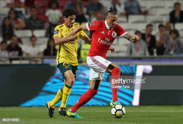 Benfica midfielder Ljubomir Fejsa from Serbia with FC Pacos de Ferreira midfielder Vasco Rocha from Portugal in action during the Primeira Liga match...