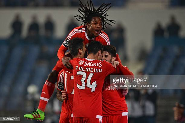 Benfica players celebrate after Benfica's Greek forward Konstantinos Mitroglou scored against Os Belenenses during the Portuguese league football...