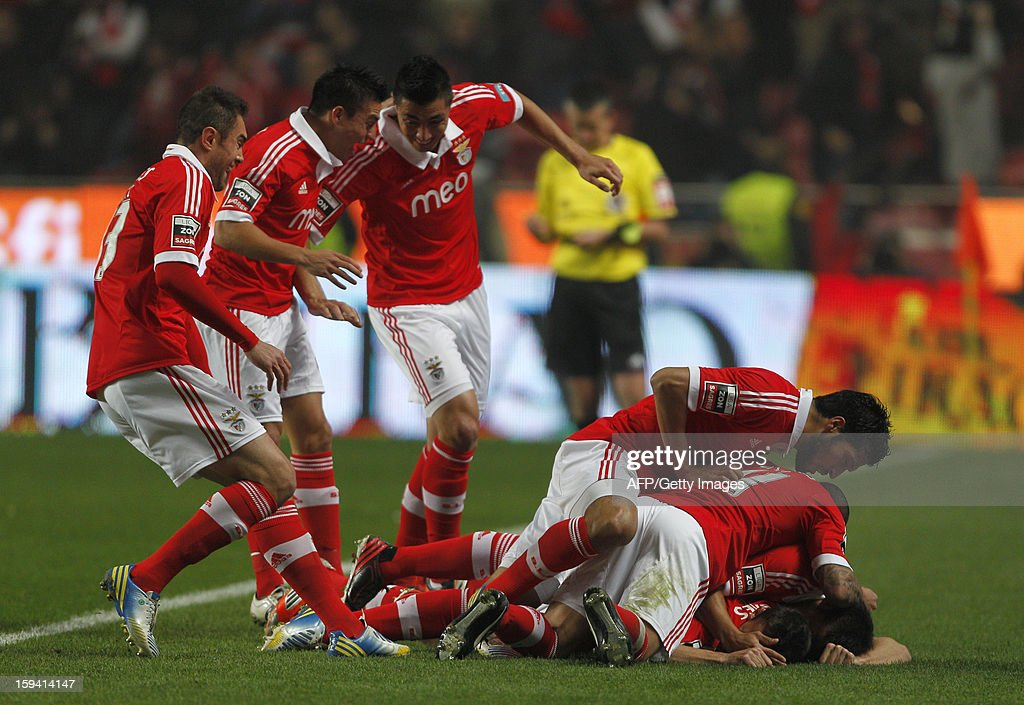SL Benfica players celebrate after scoring during the Portuguese league football match SL Benfica vs FC Porto at Luz Stadium in Lisbon on January 13, 2013.