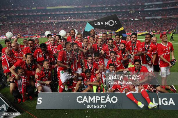 Benfica players celebrating the tetra title with his team mates after the match between SL Benfica and Vitoria SC for the Portuguese Primeira Liga at...