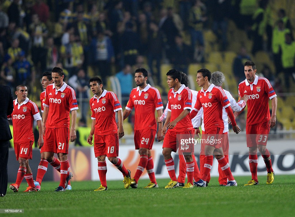 Benfica players leave the pitch after an UEFA Europa League semi-final football match between Fenerbahce and Benfica at Sukru Saracoglu stadium on April 25, 2013 in Istanbul.