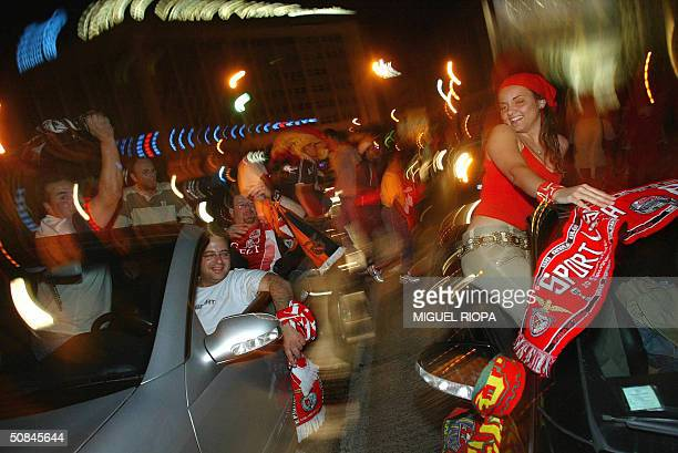 Benfica supporters celebrate at Marques de Pombal Square in Lisbon 16 May 2004 after their victory of the Portugal Cup against FC Porto AFP Photo /...