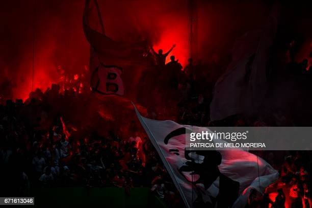 Benfica supporters celebrate their team's equalizer goal during the Portuguese League football match Sporting CP vs SL Benfica at Alvalade stadium on...