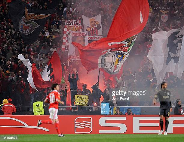 Benfica supporters wave banners during the UEFA Europa League quarter final first leg match between Benfica and Liverpool at the Estadio de Luz on...
