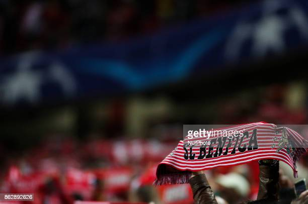Benfica supporters waving their scarfs during the Champions League football match between SL Benfica and Manchester United at Luz Stadium in Lisbon...