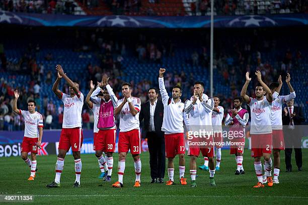 Benfica team greets their fans after winning the the UEFA Champions League Group C match between Club Atletico de Madrid and SL Benfica at Vicente...