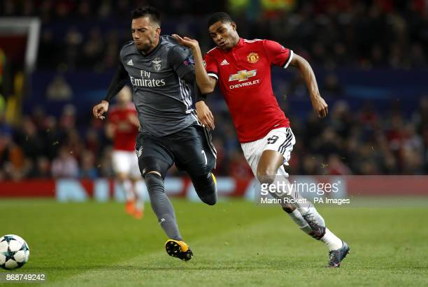 Benfica's Andreas Samaris and Manchester United's Marcus Rashford battle for the ball during the UEFA Champions League Group A match at Old Trafford...
