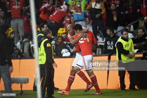 Benfica's Argentine defender Ezequiel Garay celebrates with his teammate Benfica's Brazilian defender Luis Da silva 'Luisao' after scoring a goal...