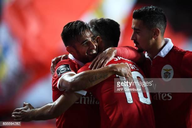 Benfica's Argentine midfielder Eduardo Salvio celebrates with his teammates Benfica's Brazilian forward Jonas Oliveira and Benfica's defender Andre...
