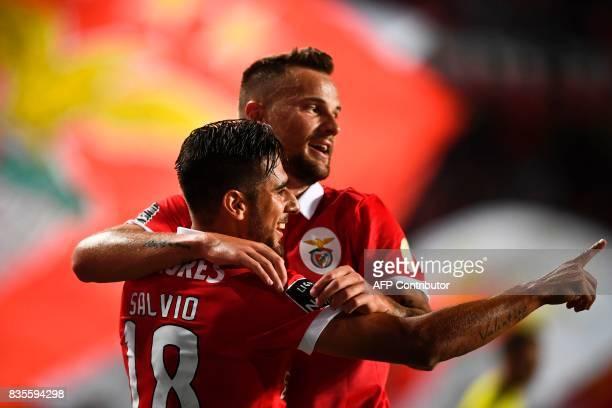 Benfica's Argentine midfielder Eduardo Salvio celebrates with his teammate Benfica's Swiss forward Haris Seferovic after scoring during the...