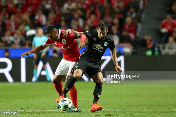 Benfica's Argentine midfielder Eduardo Salvio fights for the ball with Manchester United's Armenian midfielder Henrikh Mkhitaryan during the UEFA...
