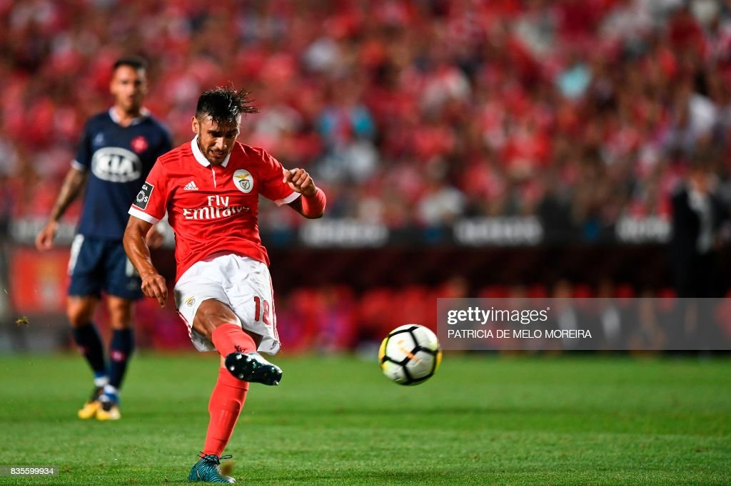 Benfica's Argentine midfielder Eduardo Salvio kicks the ball to score during the Portuguese League football match SL Benfica vs Os Belenenses at Luz stadium on August 19, 2017. /