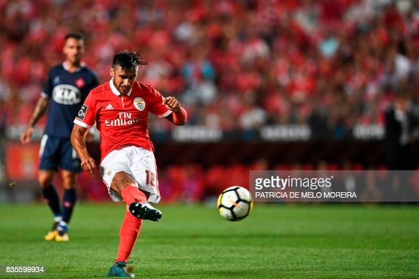 Benfica's Argentine midfielder Eduardo Salvio kicks the ball to score during the Portuguese League football match SL Benfica vs Os Belenenses at Luz...