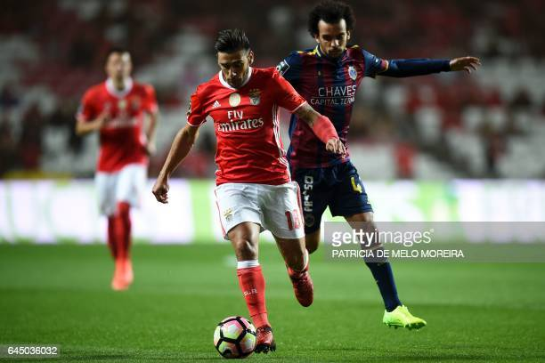 Benfica's Argentine midfielder Eduardo Salvio vies with Chaves' forward Fabio Martins during the Portuguese league football match SL Benfica vs GD...